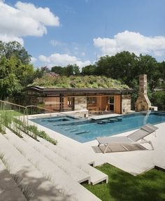 Pool house with a green rooftop