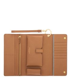 <p>The Uptown Out & About Wallet is for the Bendel Girl who's all…