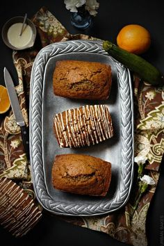 Orange Zucchini Bread with orange glaze.  A recipe for 4 mini loaves.   urbanbakes.com