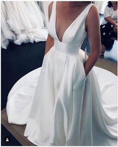 Simply stunning and on the way for our Leah Da Gloria in August! Tag your girls! Leah Da Gloria Trunk Show August . Wedding Dress With Pockets, V Neck Wedding Dress, Gown Wedding, Outdoor Wedding Dress, Wedding Dress Necklines, Straps Prom Dresses, Ball Dresses, Wedding Ceremony, Pretty Wedding Dresses