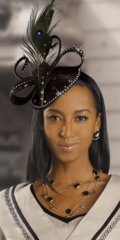 black hat for women | This hat is reminiscent those commonly worn to weddings in the U.K