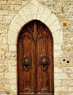 A beautiful carved & arched door, I just love old and old fashioned doors.