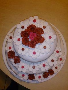 1. Cake: Cocos with Papaya-Cream 2. Cake: Stracciatella with Japonaise-cream 3. Cake: Lemon with Strawberry-cream, on the hole cake are Sugar-Roses and Flowers