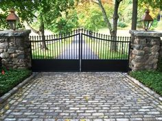 Automated Iron Driveway Gate- Simple design and like the solid portion on bottom (for keeping the dog in). Front Gates, Entrance Gates, Front Fence, Driveway Entrance, Iron Gates Driveway, Brick Columns, Driveway Landscaping, Wrought Iron Gates, Front Entrances