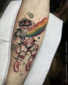 arm tattoo astronaut and rainbow