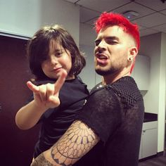 Adam Lambert and his Godson Riff Cherry behind the scenes at Hollywood Bowl.