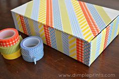 Cover an otherwise boring box. | 56 Adorable Ways To Decorate With Washi Tape