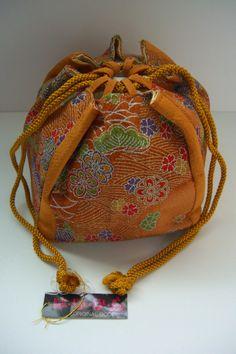 Vintage Japanese chirimen kinchaku drawstring bag with cordsFrom StyledinJapan