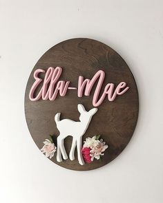Baby Nursery name sign with deer and flowers by Wellwood Designs. Decor for woodland theme nursery.