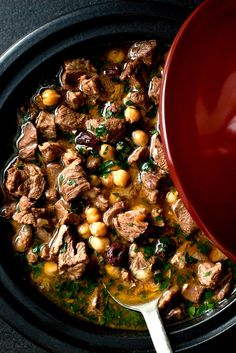 "NYT Cooking: Traveling in Morocco years ago, I had eaten tagines — stews distinguished by being cooked in the pot of the same name — that I did not recall as involving any browning.This method is described as ""starting the tagine cold. Tagine Cooking, Lamb Tagine Slow Cooker, Beef Tagine, Cooking Lamb, Meat Recipes, Cooking Recipes, Best Lamb Recipes, Tagine Recipes, Lamb Tagine Recipe"