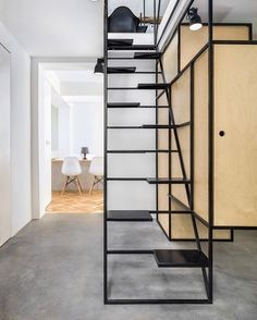 At a Bulgarian residence by DontDIY, a wireframe aesthetic defines a black-painted steel staircase, which incorporates storage for a wardrobe and washing machine on the other side. : Assen Emilov. @sandow... - Interior Design Ideas, Interior Decor and Designs, Home Design Inspiration, Room Design Ideas, Interior Decorating, Furniture And Accessories