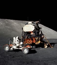 "humanoidhistory: ""December 11, 1972 – Apollo 17 astronaut Gene Cernan checks out the lunar rover at the Taurus-Littrow landing site. (NASA) """