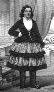 reform dress. I suspect this may be English, but not sure. It almost looks like a Punch caricature with the flounced skirt and narrow trousers.