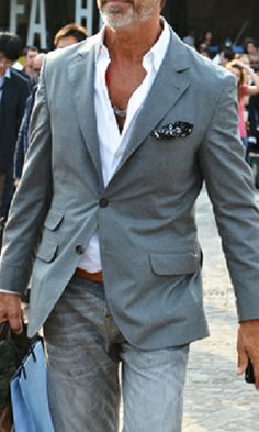 Nice jeans, fitted jacket, pressed up collar, interesting pocket square and a little swagger... Kudos sir!  -mp