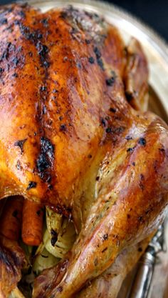 Roasted Turkey with Herb Butter and Roasted shallots....