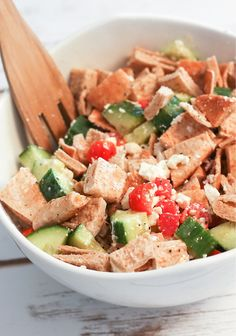 Garden Vegetable Pita Bread Salad – Cucumbers, tomatoes, red peppers, basil, pita bread pieces, and feta cheese are tossed in a lemon-garlic dressing for a tasty Mediterranean-style salad recipe. `