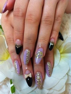 Japanese Nail Art Manicure Black and Pastel Purple nails with crystal bow and gold lacing