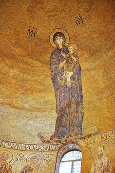 Byzantine mosaic of the Virgin Mary and Child above the altar of the Venetian-Byzantine Cathedral of Santa Maria Assunta on the island of Torcello, Venice.
