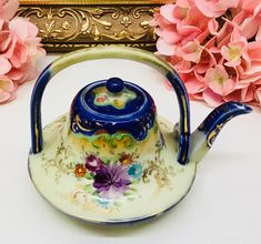Exquisite Unmarked Nippon tiny teapot.