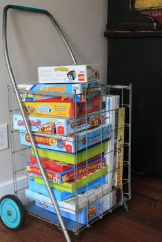 Putting games in a cart, genius. Get those games played with! via Nicole's House {Part 2} @ The Pleated Poppy
