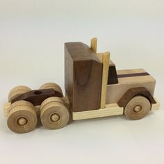 Wood Tractor Trailer Handmade wood toy Peterbilt truck style maple walnut Wood Tractor Trailer Handmade wood toy by BluebirdWoodcrafts The post Wood Tractor Trailer Handmade wood toy Peterbilt truck style maple walnut appeared first on Wood Ideas. Wooden Toy Trucks, Wooden Car, Wooden Toys, Wood Toys Plans, Wood Projects For Beginners, Build Your Own Boat, Peterbilt Trucks, Woodworking Projects Diy, Wooden Crafts