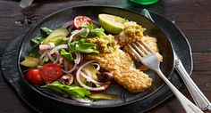 Tortilla-crusted hoki with pistachio sauce. Partnered with a tangy salad, this gluten-free alternative to classic fish and chips makes a light meal.