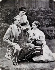"""Charles Dickens reading to his two daughters, 'Mamie' and Kate (standing) at his Gad's Hill Mansion, 1865"