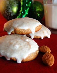 lebkuchen (german christmas cookies) w/ honey, white sugar, butter, eggs, apricot jam or orange marmalade, baking powder, baking soda, all purpose flour, almond meal, cloves, cardamom, allspice, ginger, cinnamon & lemon glaze (powdered sugar & lemon juice)