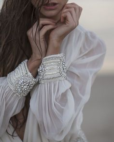 white dress with detailed cuffs