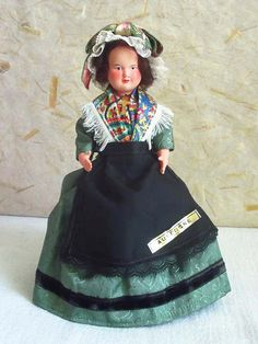 French celluloid vintage costume doll representing an Auvergnate lady from the Auvergne central region of France. Auvergne is situated in the