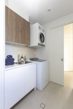 Laundry room with top loader and dryer