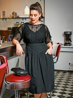 Plus-size outfit; black dress with lace