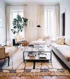 love the layered rugs over parquet wood.   Tom Delavan - Trad Home - Beni Ouarain Rug