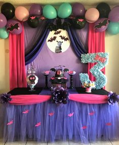 Vampirina cake table. Paper flowers/ custom table skirt.  #VampirinaParty