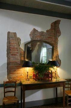 love this look of aged bricks behind plaster