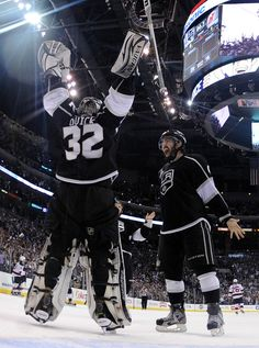 Drew Doughty #8 And Goaltender Jonathan Quick #32 Of The Los Angeles Kings Celebrate The Kings 6-1 Victory