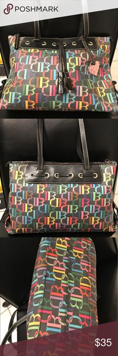 Authentic Dooney and Bourke shoulder bag Bag is in great condition.Handle is great,inside is clean.9 inch tall 15 inch wide. Dooney & Bourke Bags Shoulder Bags
