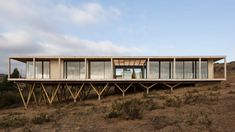 Dock House in coastal Chile by SAA rests on triangular wooden stilts - Modern Tropical House, Tropical Houses, Dock House, Wooden Terrace, House On Stilts, Box Houses, Coastal Homes, House In The Woods, Rest House
