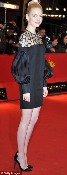 Legs to die for! Emma shows off her slim and toned legs on the red carpet