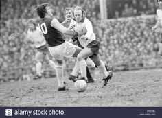13th April 1975. Derby County's Archie Gemmill battles to get the ball off West Ham playmaker Trevor Brooking.