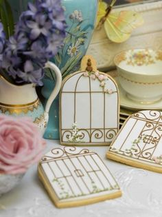 Lovely birdcage & gate iced cookies, perfect as favours for your events.
