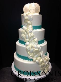 Classy Beach Wedding Cake with Turquoise Bands and chocolate sea shells