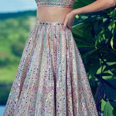 Love this multi colored mirror work lehenga Looking for the best Mumbai Lehenga Designers under budget Lakhs? Check out amazing bridal lehengas along with prices and new 2018 bridal lehengas here. Indian Lehenga, Indian Gowns, Indian Attire, Lehenga Choli, Blue Lehenga, Indian Bridal Outfits, Indian Bridal Fashion, Indian Designer Outfits, Indian Outfits Modern