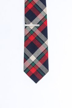 Plaid tie and tie bar.
