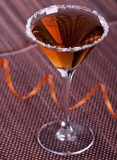 MAYHEM MARTINI ... Ingredients:    2 oz Cockspur Fine Rum  ½ oz triple sec  ½ oz Godiva Chocolate Liqueur  Orange twist for garnish.
