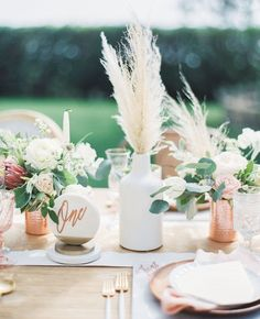 Pampas grass wedding centerpiece - pretty and modern wedding table decor idea with table number, florals, and pampas grass centerpiece. copper and white wedding. Floral Wedding, Wedding Colors, Wedding Bouquets, Green Wedding, Feather Wedding Decor, Copper Wedding Decor, Summer Wedding, Feather Wedding Centerpieces, Bohemian Wedding Flowers