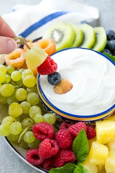 This recipe for cream cheese fruit dip is a light and creamy 3 ingredient dip that's perfect with your favorite fruit. A wholesome snack that's perfect for parties or for eating while watching TV!