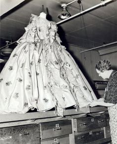 Here Inez Schroedt at MGM works on the hem of one of the gowns from Marie Antoinette (1938). Some 2500 costume were made for the film.
