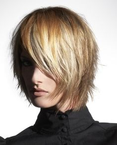 A medium blonde straight coloured choppy shaggy bob Layered hairstyle by Lnza