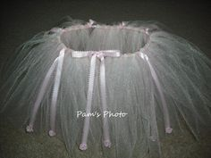 """17"""" inch pink ribbon waste band. Tulle is 10"""" inches in length. Light pink and White shimmer tulle. Pink ribbon added to tutu skirt and decorated with pink rose buds. 12 - 24 months."""